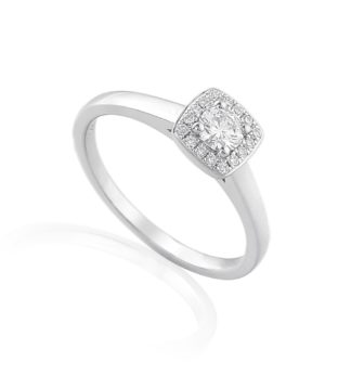 Platinum or 18ct white gold engagement ring featuring centre diamond surrounded by hale of brilliant cut diamonds