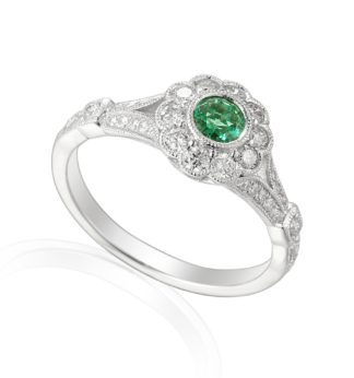 Designer 18ct white gold emerald and diamond engagement ring.