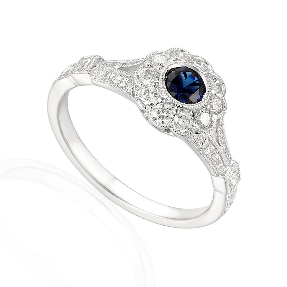 Designer 18ct white gold sapphire and diamond engagement ring.