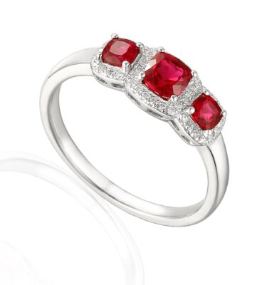 Designer Ruby and diamond trilogy engagement ring in platinum