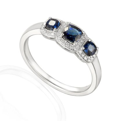 Designer Sapphire and diamond trilogy engagement ring in 18ct white gold