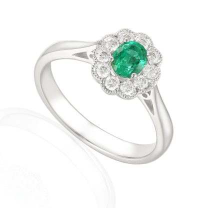 Desiginer oval emerald diamond engagement ring in 18ct white gold