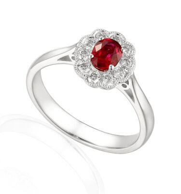 Oval ruby and diamond halo engagement ring