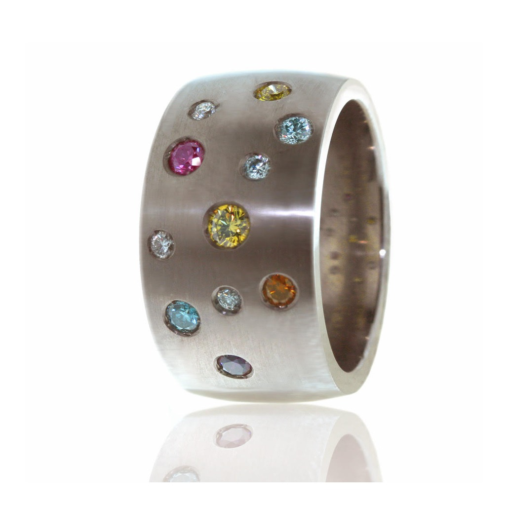 Titanium and diamond ring with coloured stones