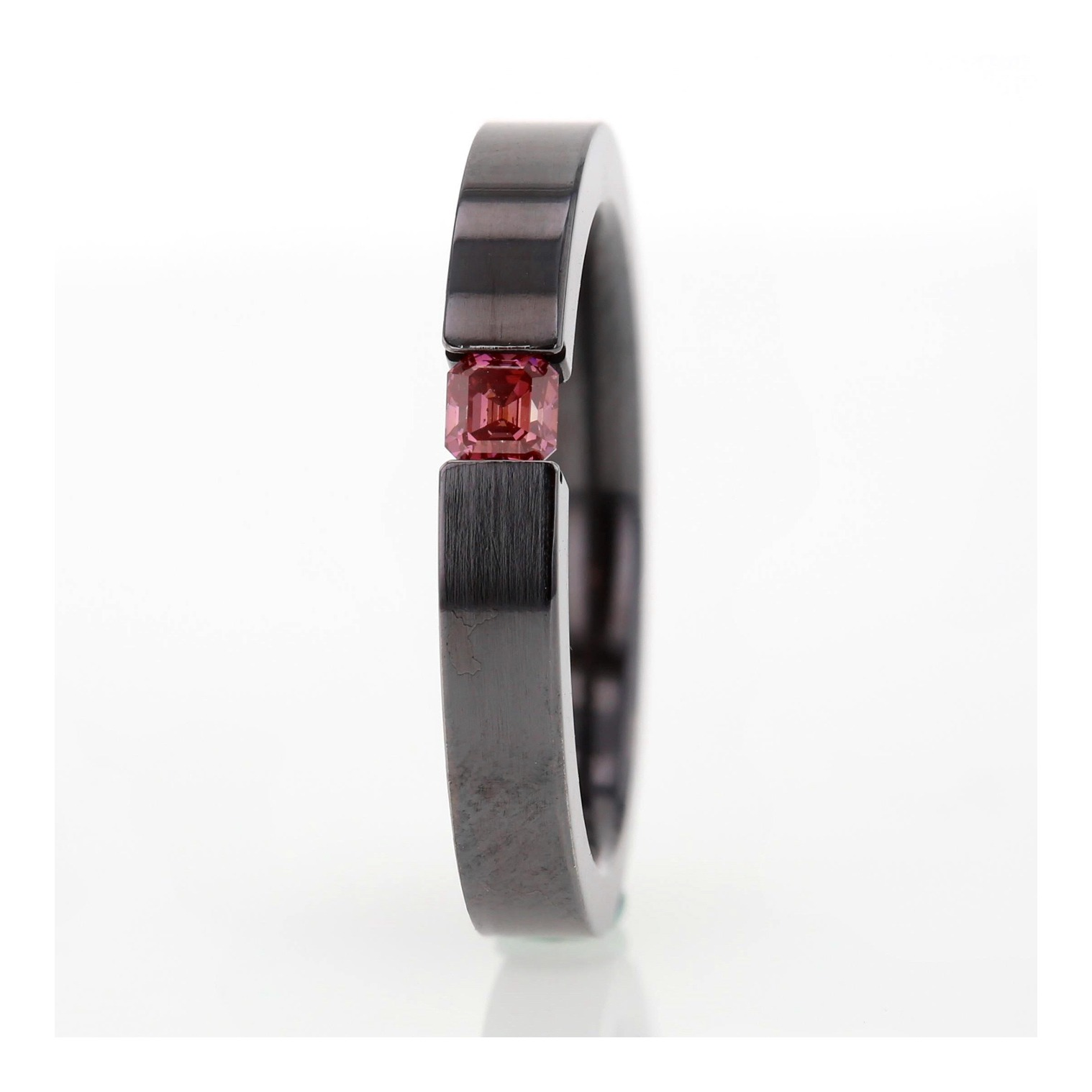 Pink diamond titanium tension set ring