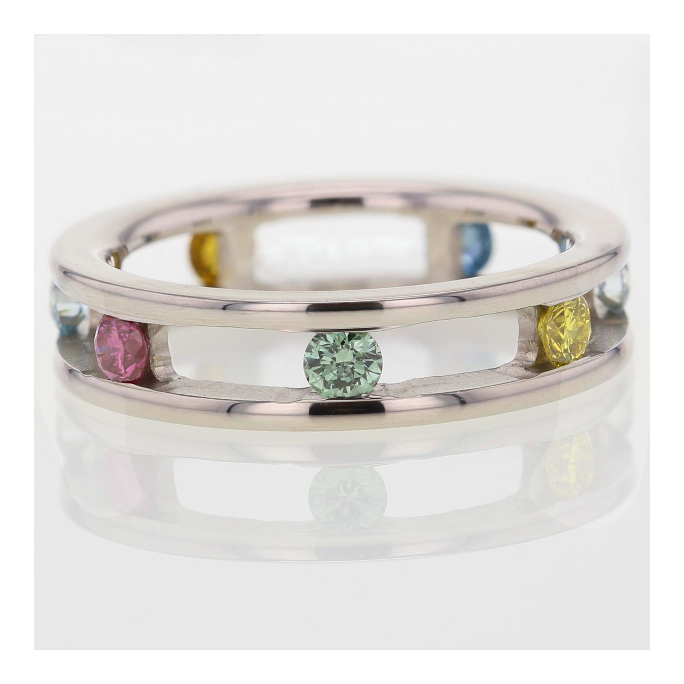 18ct White gold diamond ring with coloured stones.